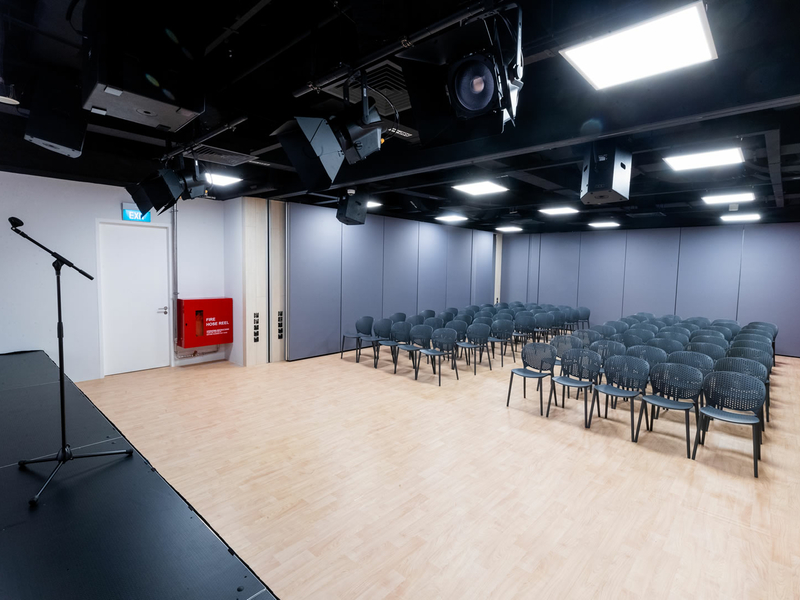 singapore seminar space with mini stage and audience chairs