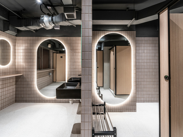 instagramable singapore event space with large beige bathroom with ovale mirror