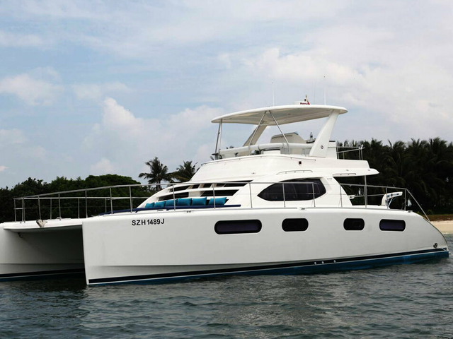 wedding anniversary party yacht in singapore with white interior and upper deck area