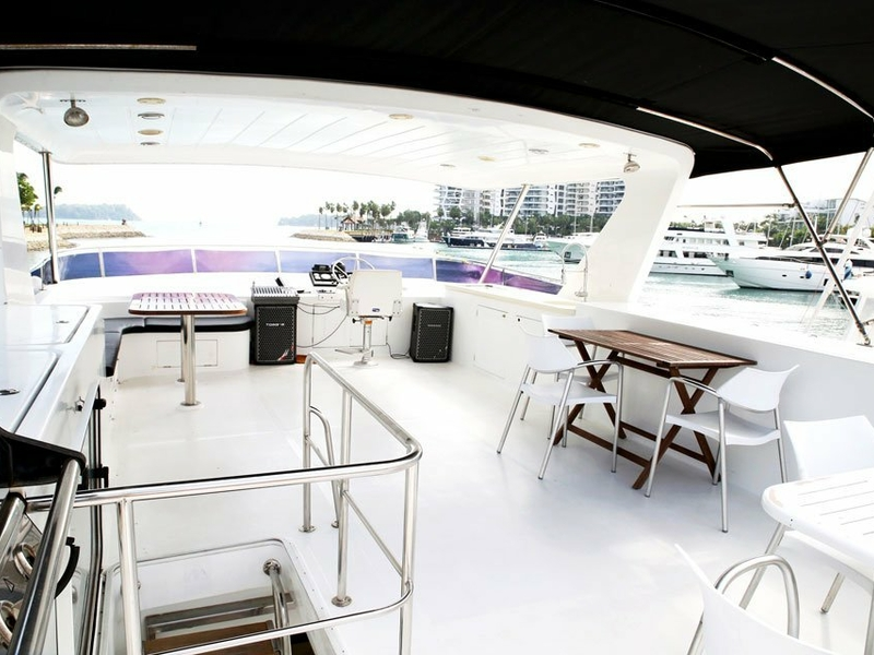 large white deck in singapore yacht with black ceiling cover