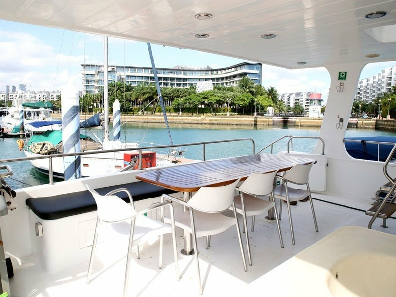 lower deck yacht with long table and several chairs