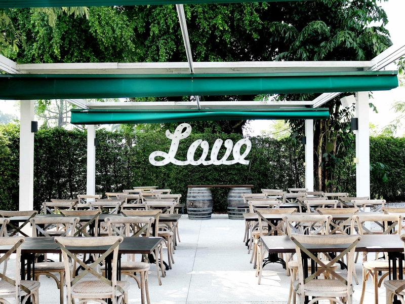 outdoor deck area with love sign age