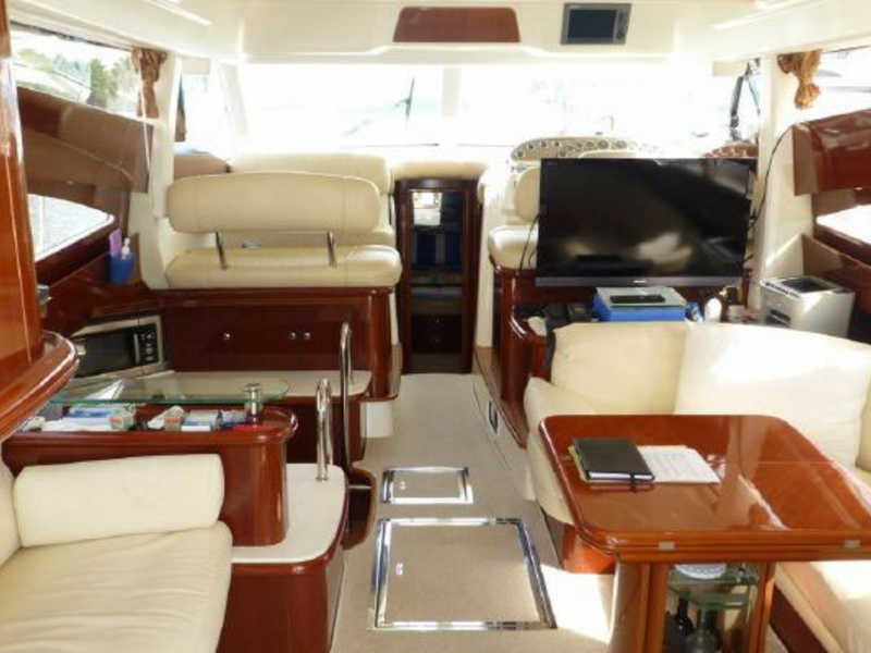 singapore yacht with small lower deck area with beige furniture