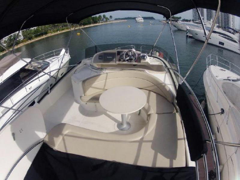 small yacht in singapore with u-shaped passanger seat