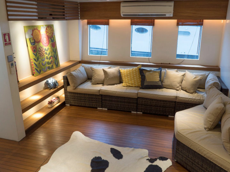 long beige couches with medium windows in singapore lower deck yacht