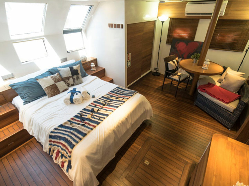 large bedroom and windows in singapore honeymoon yacht