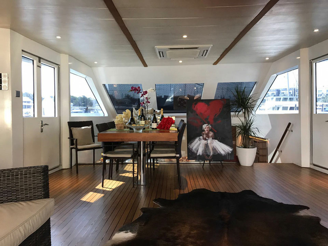 private dining room with large windows and painting in singapore yacht