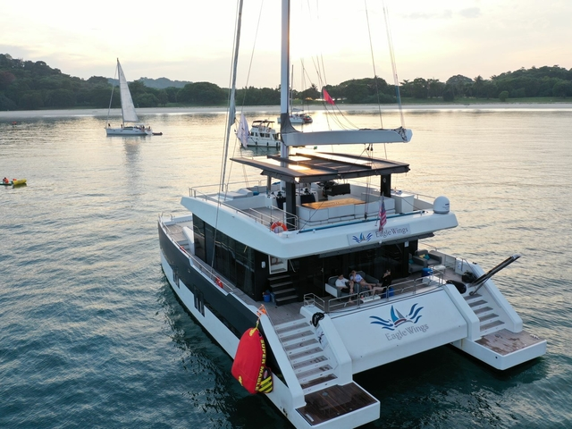 large white party yacht sailing in singapore sea