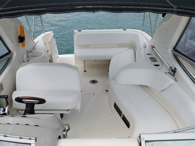 singapore white interior yacht with long couches and captain area