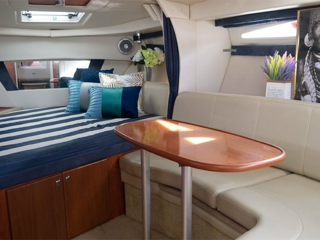 private event yacht in singapore with long couches and small bed area