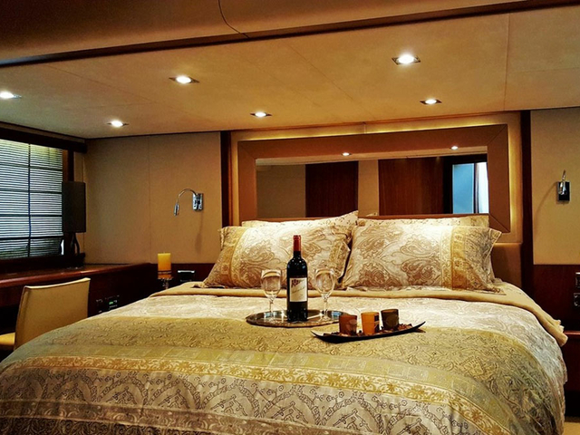 honeymoon yacht in singapore with bedroom and wine