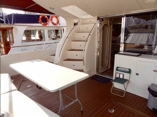 gathering event yacht in singapore equipped with mini stairs and main deck area