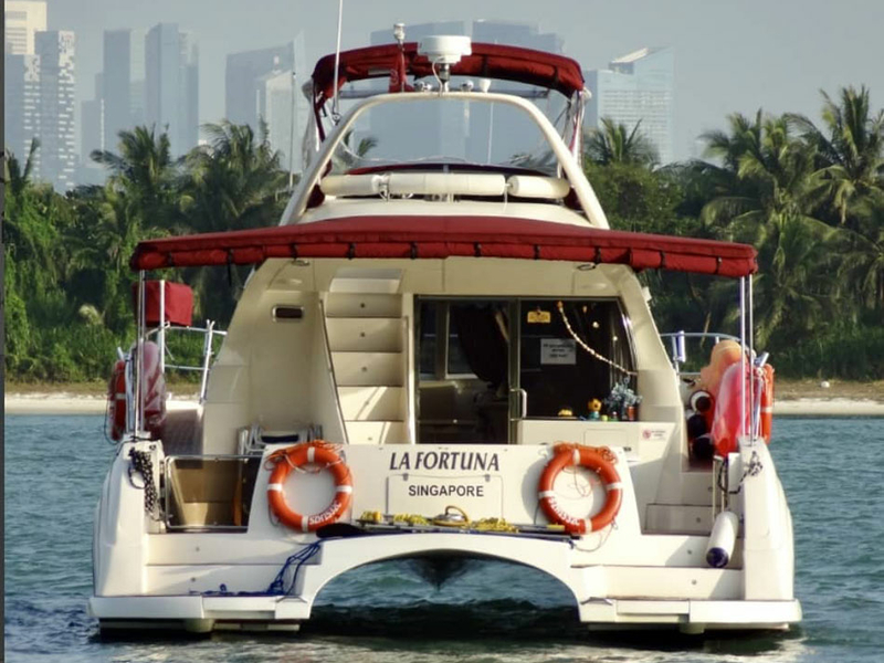bridal shower party yacht in singapore with white-red interior