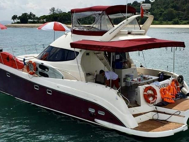 white-red interior yacht sailing in singapore sea