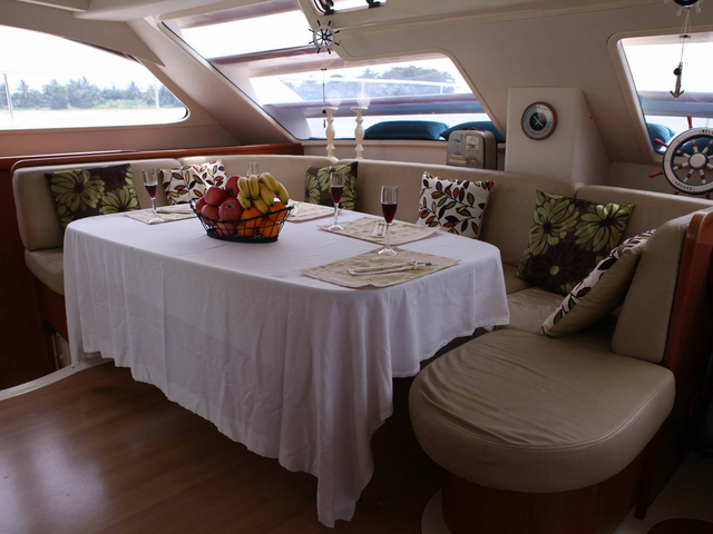 u-shaped couches with dining table in singapore romantic dinner yacht