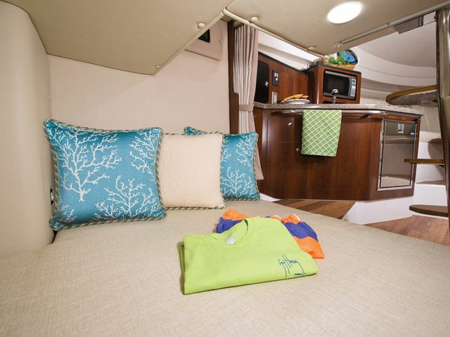 small party yacht in singapore with couches and cooking area