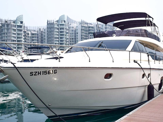 singapore white yacht leaned against the dock