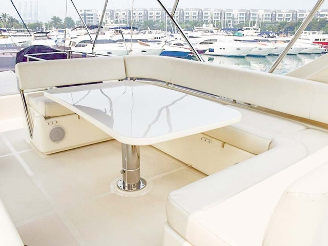 upper deck yacht in singapore with u-shaped chairs and table