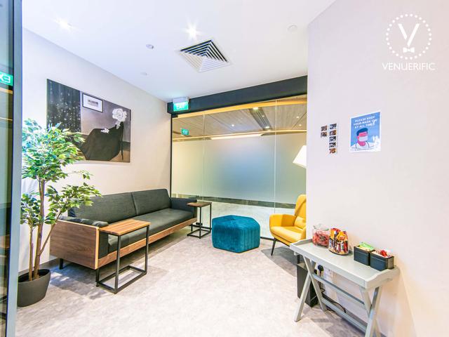 minimalistic waiting room with sofa and snacks