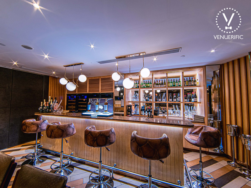 bar with modern interior and wooden barstool with a lot of alcohol drink options