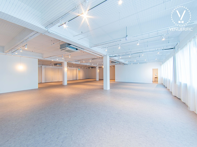 minimalist function hall with cream carpet and lighting