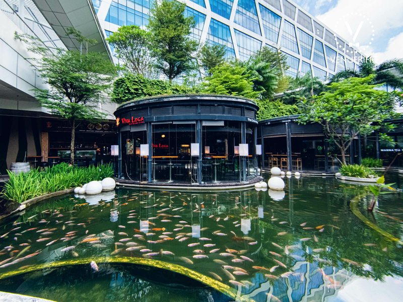 singapore restaurant with outdoor area and large fish pool