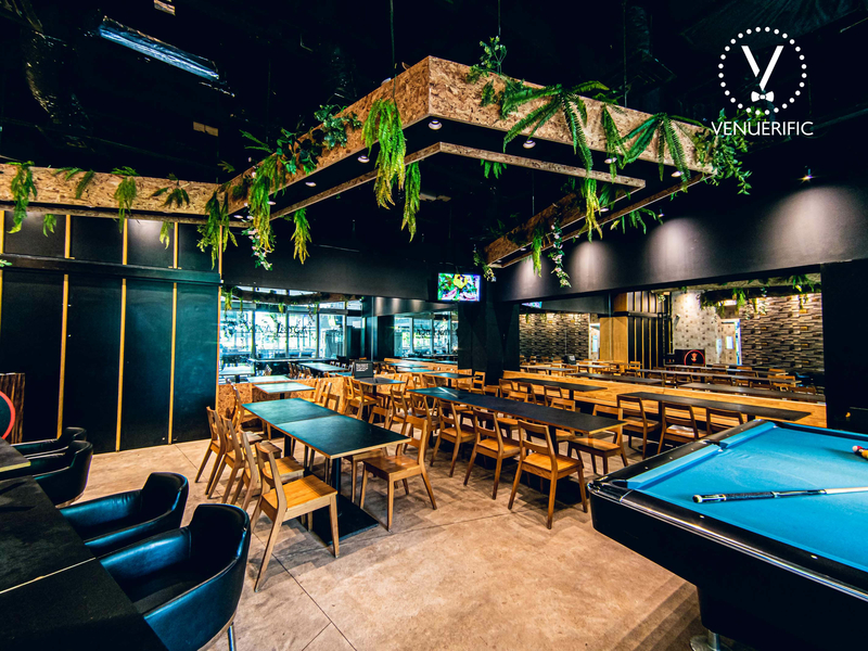 large seminar space in singapore with black interior and pool table