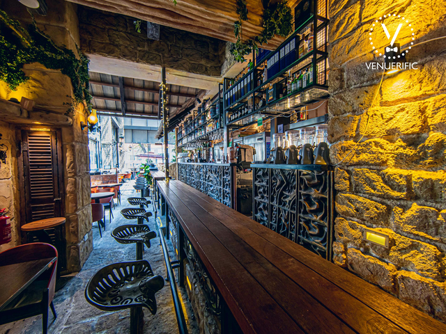 rock walls bar with wooden tables in singapore