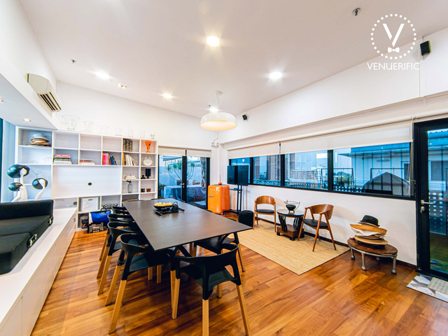 small private meeting space in singapore with long black table and wooden floors
