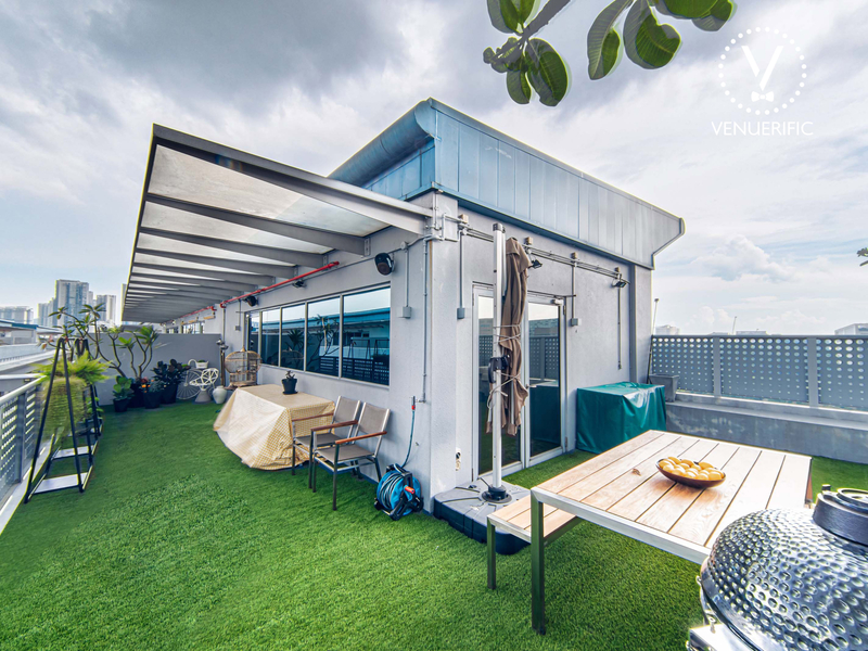 rooftop garden area equipped with table, chairs, and bbq pit