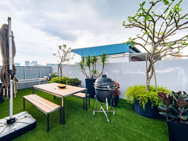 outdoor rooftop area with bbq pit