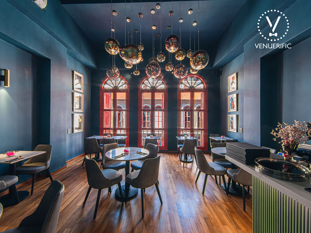 gastronomic restaurant with chandelier and blue wall