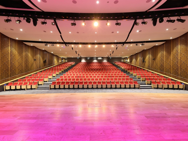 auditorium with red and gold theme