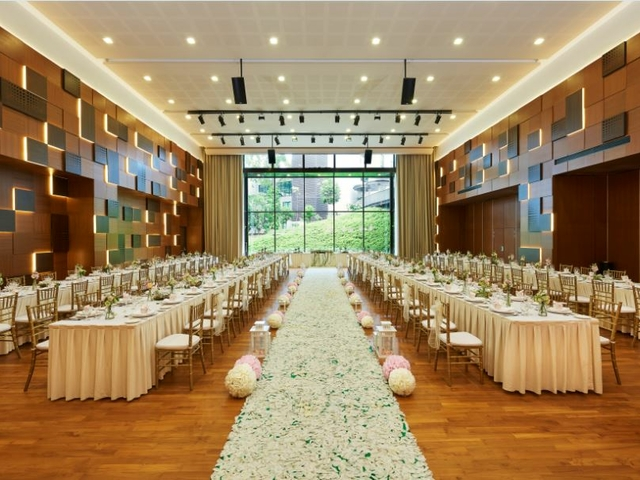 wedding reception with long white table setup at the auditorium