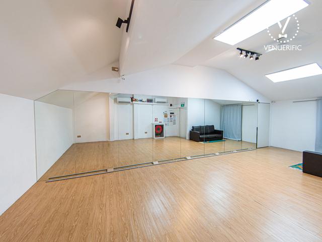 dance studio with floor to ceiling's mirror and wooden floor
