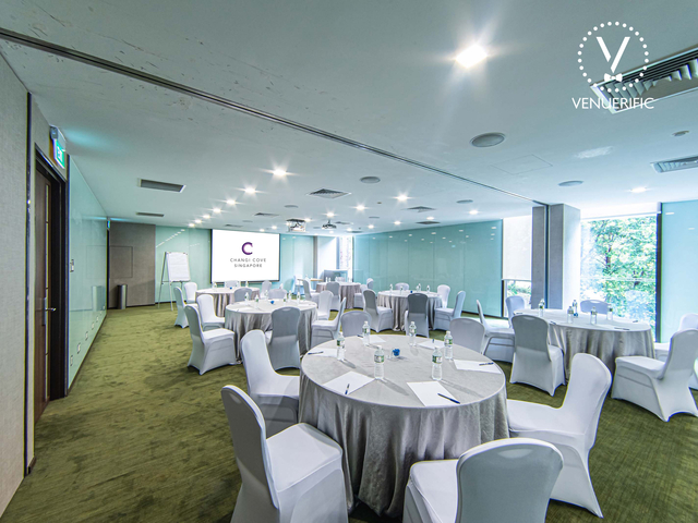 meeting room with round table setup and green carpet