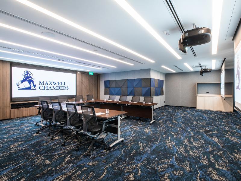 u shape meeting room setup with modern blue carpet