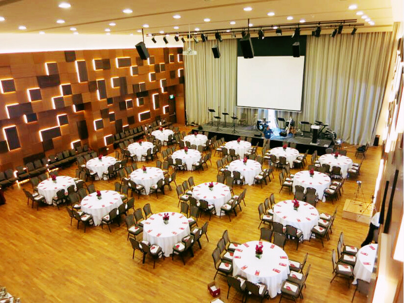 auditorium with round table and stage setup