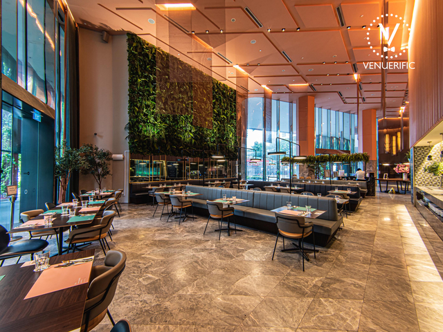 restaurant with floor to ceiling glass panels with abundant natural daylight