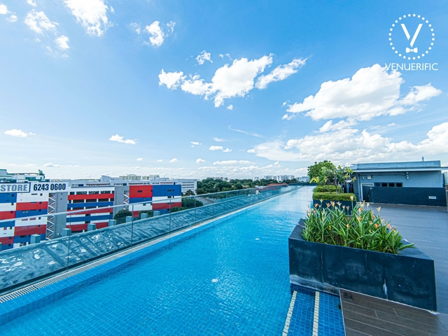 rooftop pool with city view at the sunny day