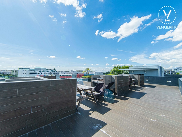 rooftop event space area with clear blue sky view