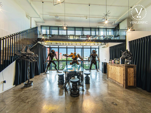 industrial event space with metal sculptures