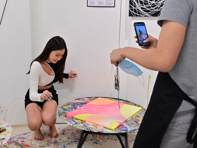 woman influencer taking her photo with her beautiful masterpiece