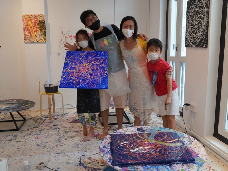 happy family spend their weekend at the art jamming studio