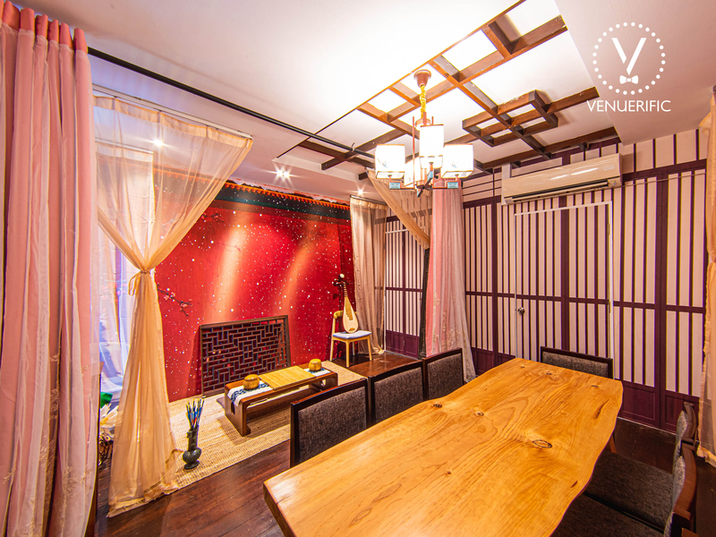elegant chinese theme room with red backdrop and curtains