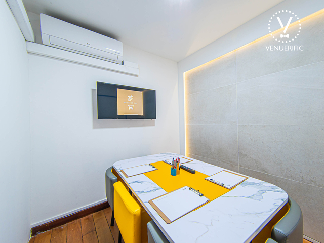 meeting room using marble table and equipped with tv screen on the wall