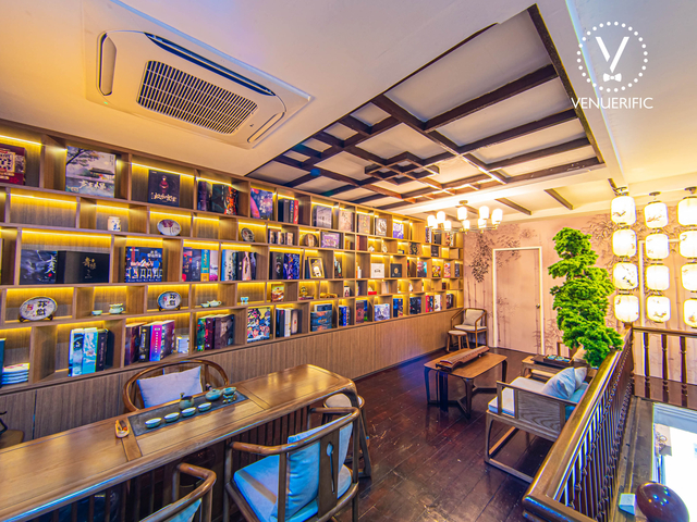 chinese theme lounge with a wooden bookshelf full of books and display