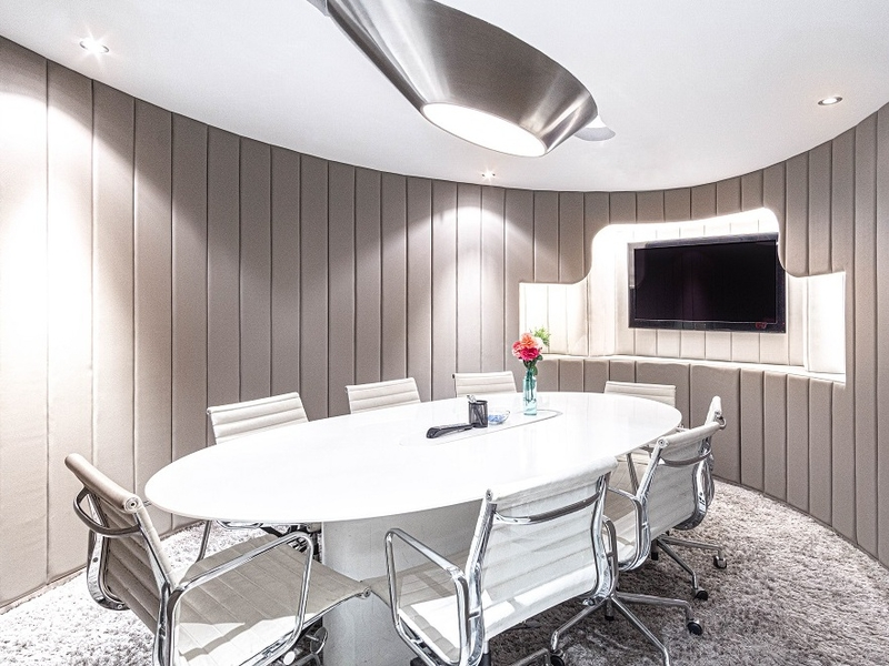 meeting room equipped with tv screen on the wall
