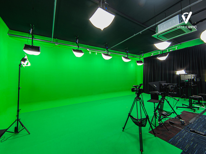 green screen studio equipped with camera and lighting