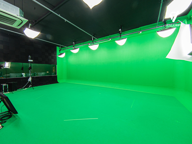 green screen studio with production and streaming equipment